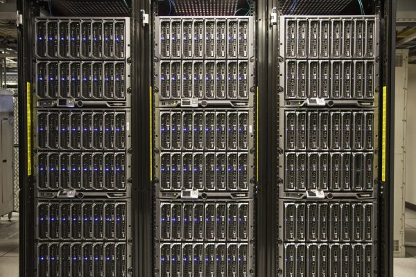 Servers on racks in a large computere server farm.